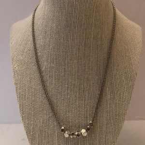 Fossil silver necklace with charms